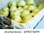 fresh harvest of apples in a... | Shutterstock . vector #699073699