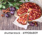 plum pie with fresh plums on a... | Shutterstock . vector #699086809