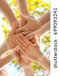 young people putting hands... | Shutterstock . vector #699093241