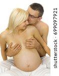 beautiful pregnant couple... | Shutterstock . vector #699097921