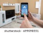 close up of a human hand... | Shutterstock . vector #699098551