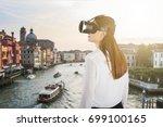rear view of a woman wearing... | Shutterstock . vector #699100165