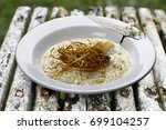 risotto with brie cheese | Shutterstock . vector #699104257