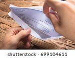 cropped hands of businessman... | Shutterstock . vector #699104611