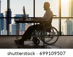 Disabled Businessman Sitting I...