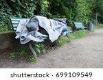 Homeless Man In Hood Sleeping...