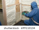 the builder in a blue suit...   Shutterstock . vector #699110134