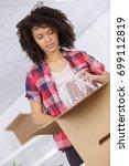 woman unpacking unboxing...   Shutterstock . vector #699112819