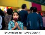 girl biting a caramel apple at... | Shutterstock . vector #699120544