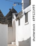 trullo wall with shadow from... | Shutterstock . vector #699121495