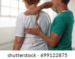senior woman having... | Shutterstock . vector #699122875