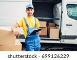 workman or courier holds carton ...   Shutterstock . vector #699126229