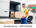workman or courier holds carton ...   Shutterstock . vector #699126265