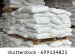sacks of flour on pallets made... | Shutterstock . vector #699134821