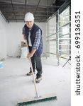 man using a brush on cement...   Shutterstock . vector #699136351