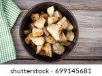 diced homemade roasted... | Shutterstock . vector #699145681