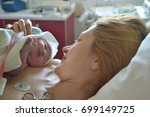 the first moments of mother and ... | Shutterstock . vector #699149725