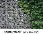 gabion wall | Shutterstock . vector #699162454