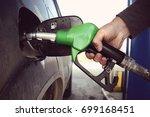 fill up fuel at petrol station. ... | Shutterstock . vector #699168451