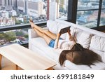 asian young model lying and... | Shutterstock . vector #699181849