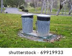two aluminum trash cans in park | Shutterstock . vector #69919933