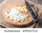 chopped onion on a chopping...