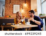 couple of young people drinking ... | Shutterstock . vector #699239245