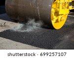 road roller compacting asphalt   Shutterstock . vector #699257107