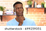 thinking  pensive black young... | Shutterstock . vector #699259351