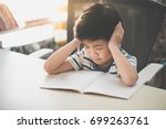 unhappy asian child working on... | Shutterstock . vector #699263761