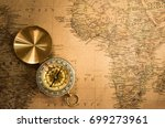 compass is on the vintage map... | Shutterstock . vector #699273961