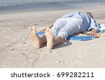 barefoot woman relaxing on the... | Shutterstock . vector #699282211