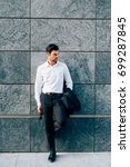 Small photo of young bearded businessman outdoor posing looking away - ambition, business attire, attitude concept
