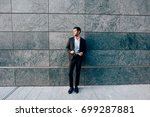 young bearded businessman... | Shutterstock . vector #699287881
