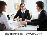 group of business people at a...   Shutterstock . vector #699291049