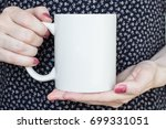 girl is holding white cup  mug... | Shutterstock . vector #699331051
