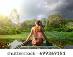 tourist with backpack travels... | Shutterstock . vector #699369181