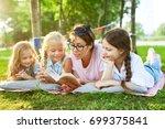 teacher and three little girls... | Shutterstock . vector #699375841
