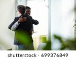 happy colleagues greeting one... | Shutterstock . vector #699376849