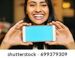 a smiling young indian woman... | Shutterstock . vector #699379309