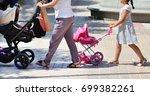 mother walking with daughter...   Shutterstock . vector #699382261