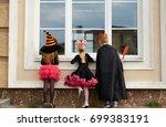 halloween boy and girls looking ... | Shutterstock . vector #699383191