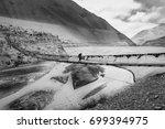 the traveler walks on a... | Shutterstock . vector #699394975