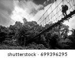 a lonely traveler walks along a ... | Shutterstock . vector #699396295
