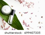 white cream bottle placed ... | Shutterstock . vector #699407335