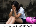 asian woman is crying and... | Shutterstock . vector #699420421