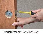 installing the door handle with ...   Shutterstock . vector #699424069