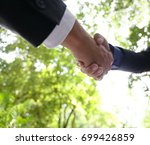 businessman handshake for... | Shutterstock . vector #699426859