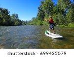 paddle boarding the boise river ... | Shutterstock . vector #699435079
