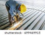 worker is welding rebar shear... | Shutterstock . vector #699469915